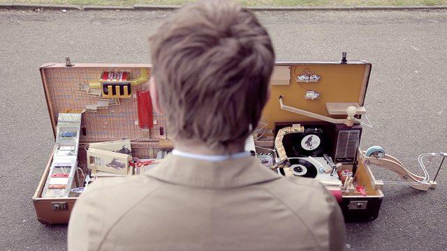 A Postcard Writing Rube Goldberg Machine in a Suitcase video art Rube Goldberg machines