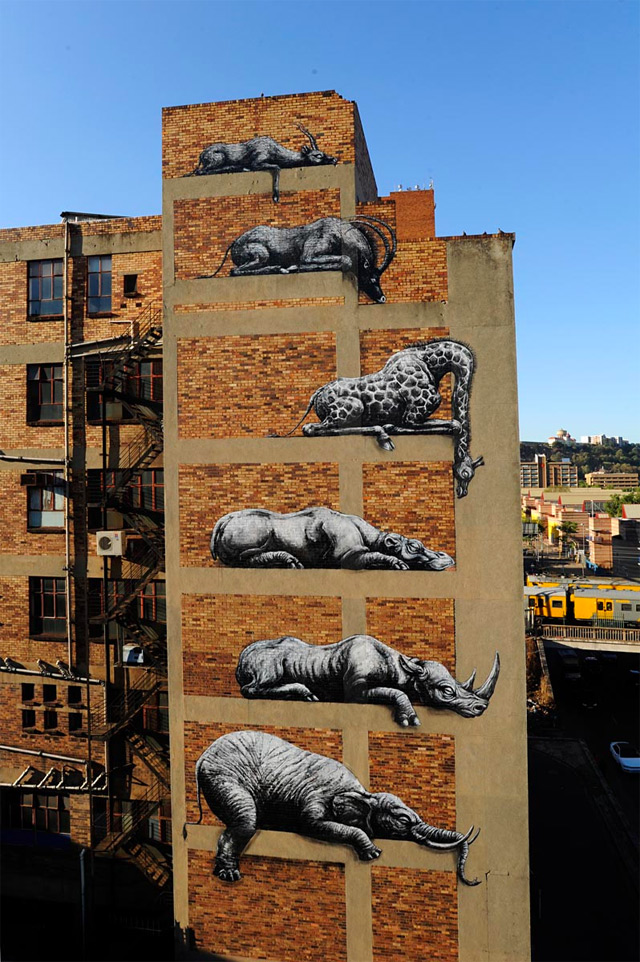 ROA Stacks African Animals on a Building Facade in Johannesburg