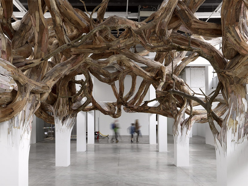 Architectural Columns at the Palais de Tokyo Explode into Organic Forms wood installation architecture