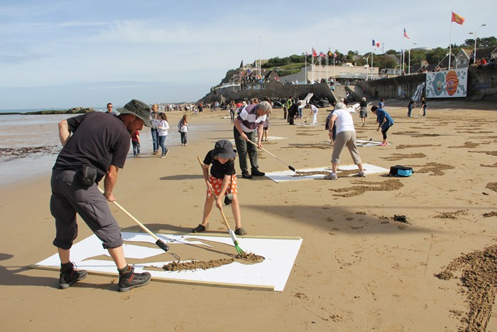 This Past Weekend British Artists Jamie Wardley And Andy Moss Accompanied By Numerous Volunteers Took To The Beaches Of Normandy With Rakes Stencils In