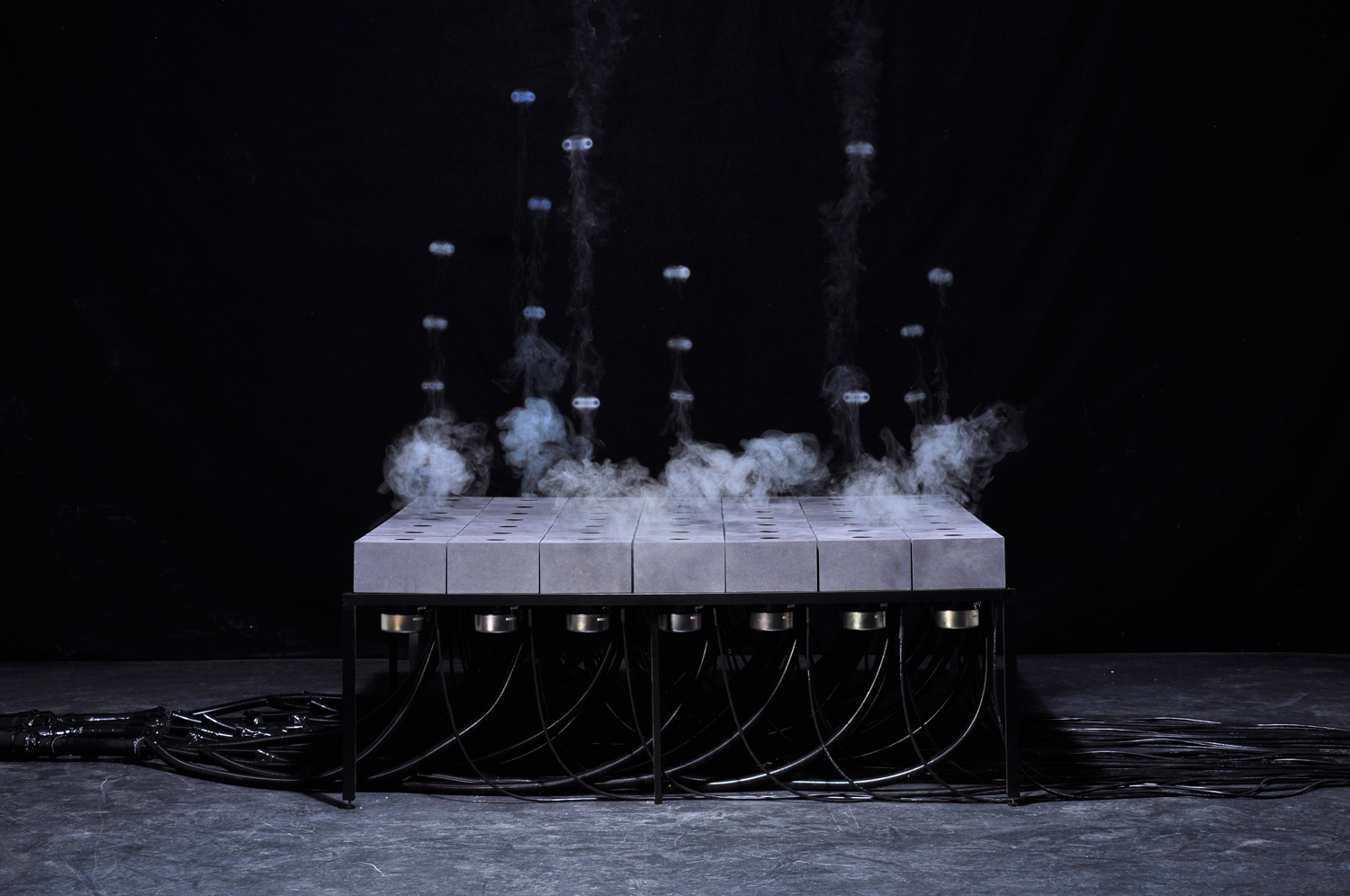 A Grid of Audio Speakers That Shoots Fleeting Patterns of Fog by Daniel Schulze sound installation fog