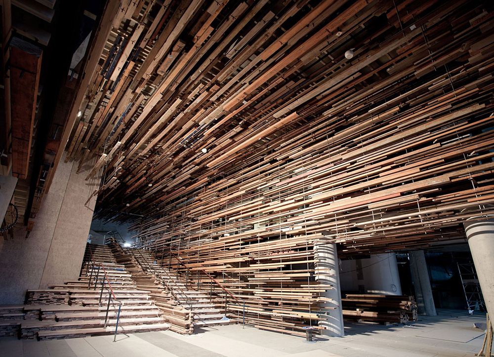 Stunning Entryway of the Nishi Building Includes a Suspended Ceiling of 2,150 Reclaimed Boards from Old Homes and a Basketball Court | Colossal