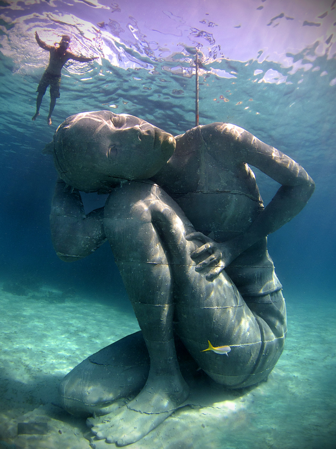 Ocean Atlas: A Massive Submerged Girl Carries the Weight of the Ocean sculpture ocean environment