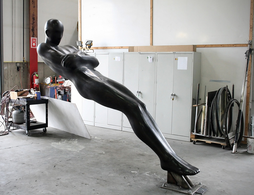 Emil Alzamoras Distorted Human Figures Appear to Melt, Morph, and Defy Gravity sculpture anatomy