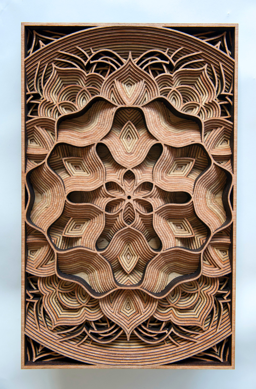 Laser cuts through wood relief sculptures by gabriel