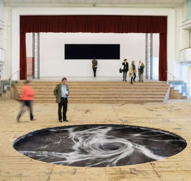 Anish Kapoor's Perpetual Black Water Whirlpool Installed in the Floor of a Former Movie Theater in Italy
