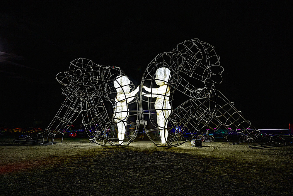 Large Wire-Frame Sculpture Shows the Glowing Forms of Children Trapped Within Adult Bodies | Colossal