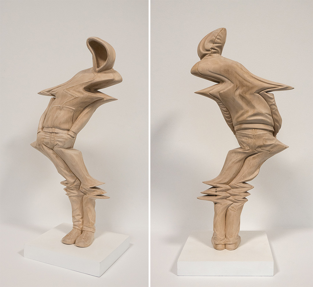Warped human forms hand carved from wood by paul kaptein