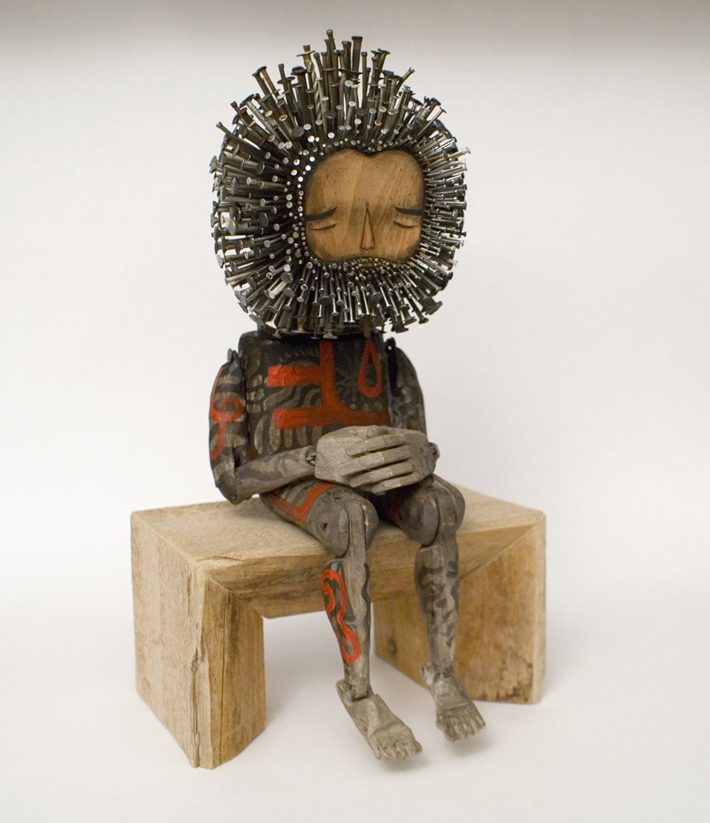 Figurative found wood sculptures pierced with hundreds of
