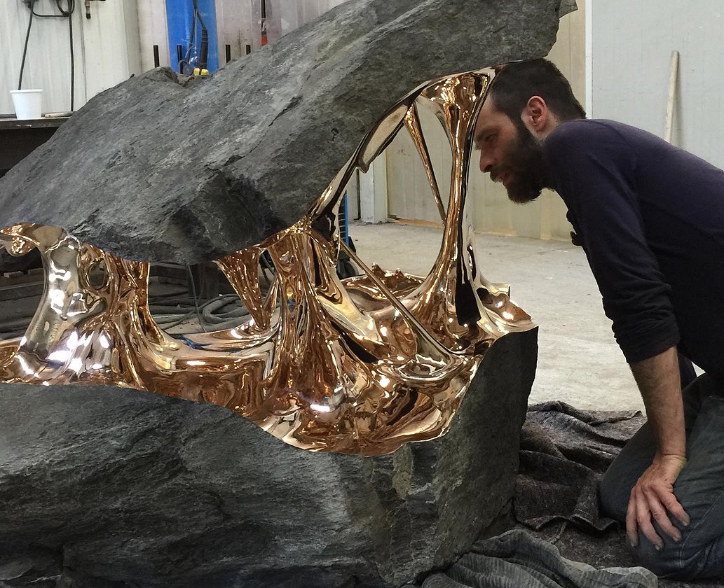 Bisected boulders with stretched bronze interiors by for Artiste creation