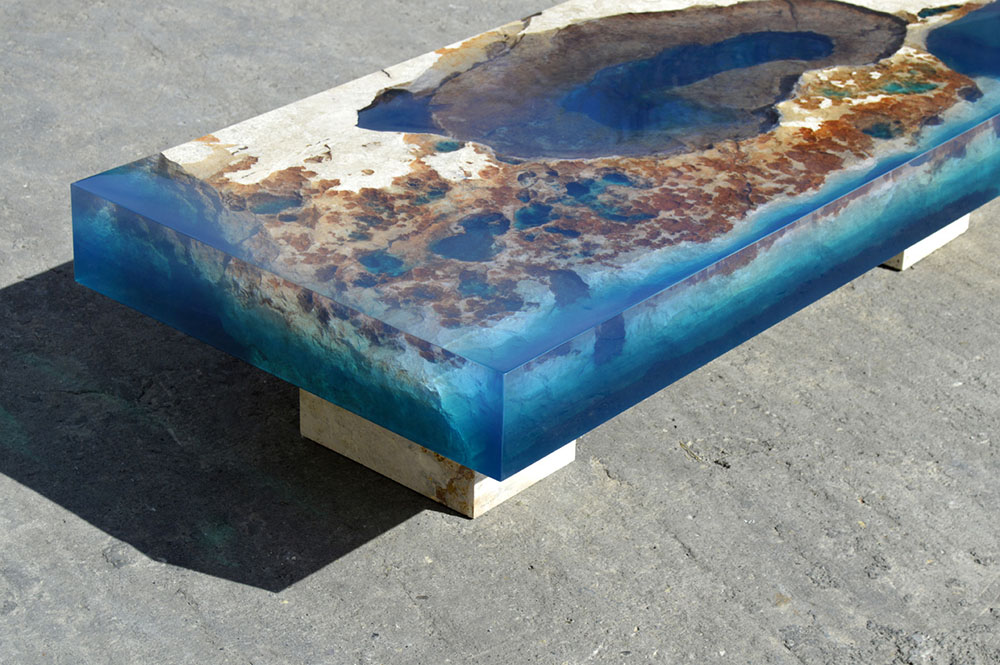 new cut stone tables encased in resin mimic an ocean reef. Black Bedroom Furniture Sets. Home Design Ideas