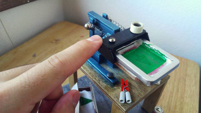 A Miniature T-Shirt Screen Printing Rig Designed by Devin Smith