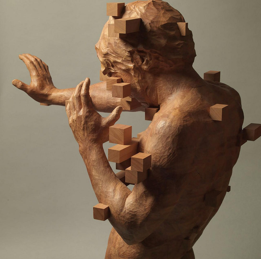 Pixelated wood sculptures carved by hsu tung han colossal