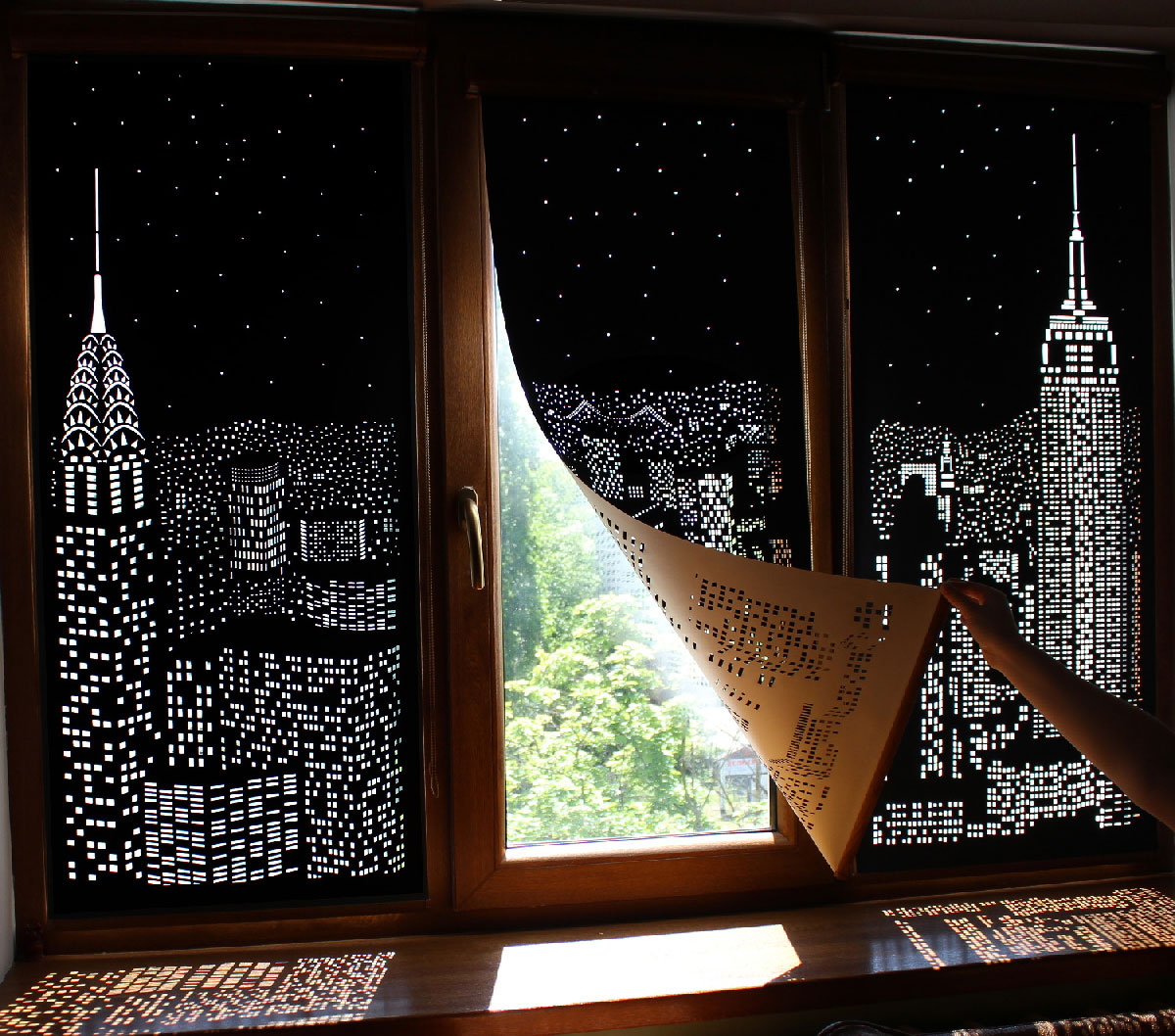 a ukrainian blind company called holeroll shared this fun set of concept blinds that feature iconic cityscapes cut into blackout curtains
