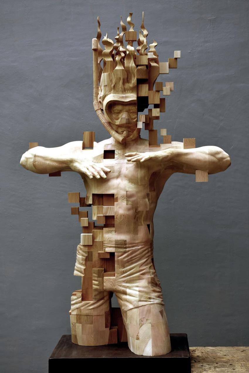 A Pixelated Wooden Snorkeler Sculpted by Hsu Tung Han Artes & contextos han 1