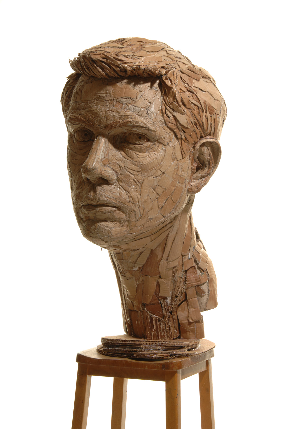 Figurative Sculptures Formed From Recycled Cardboard By