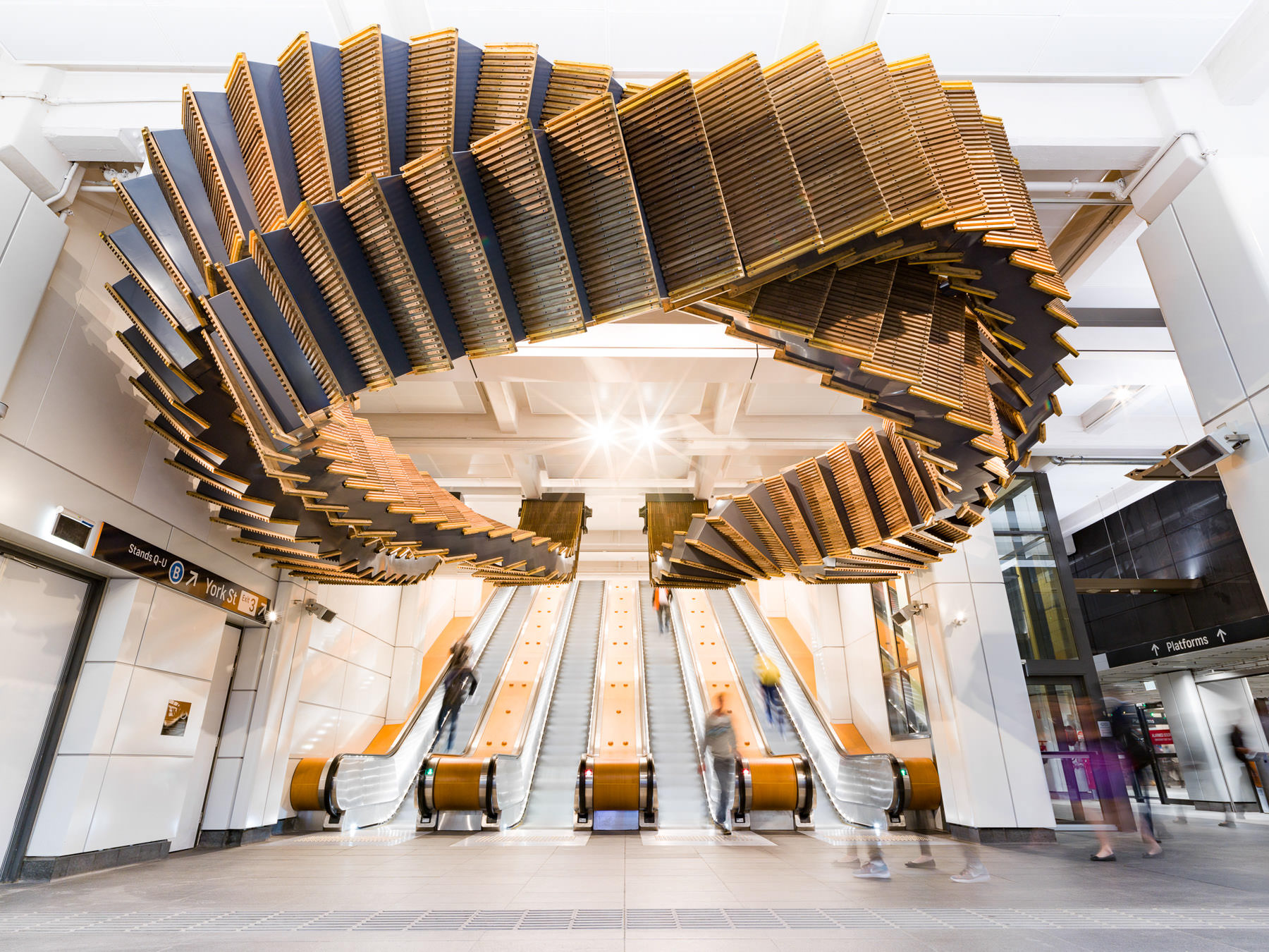80-Year-Old Wooden Escalators are Repurposed as a Sculptural Ribbon by Artist Chris Fox