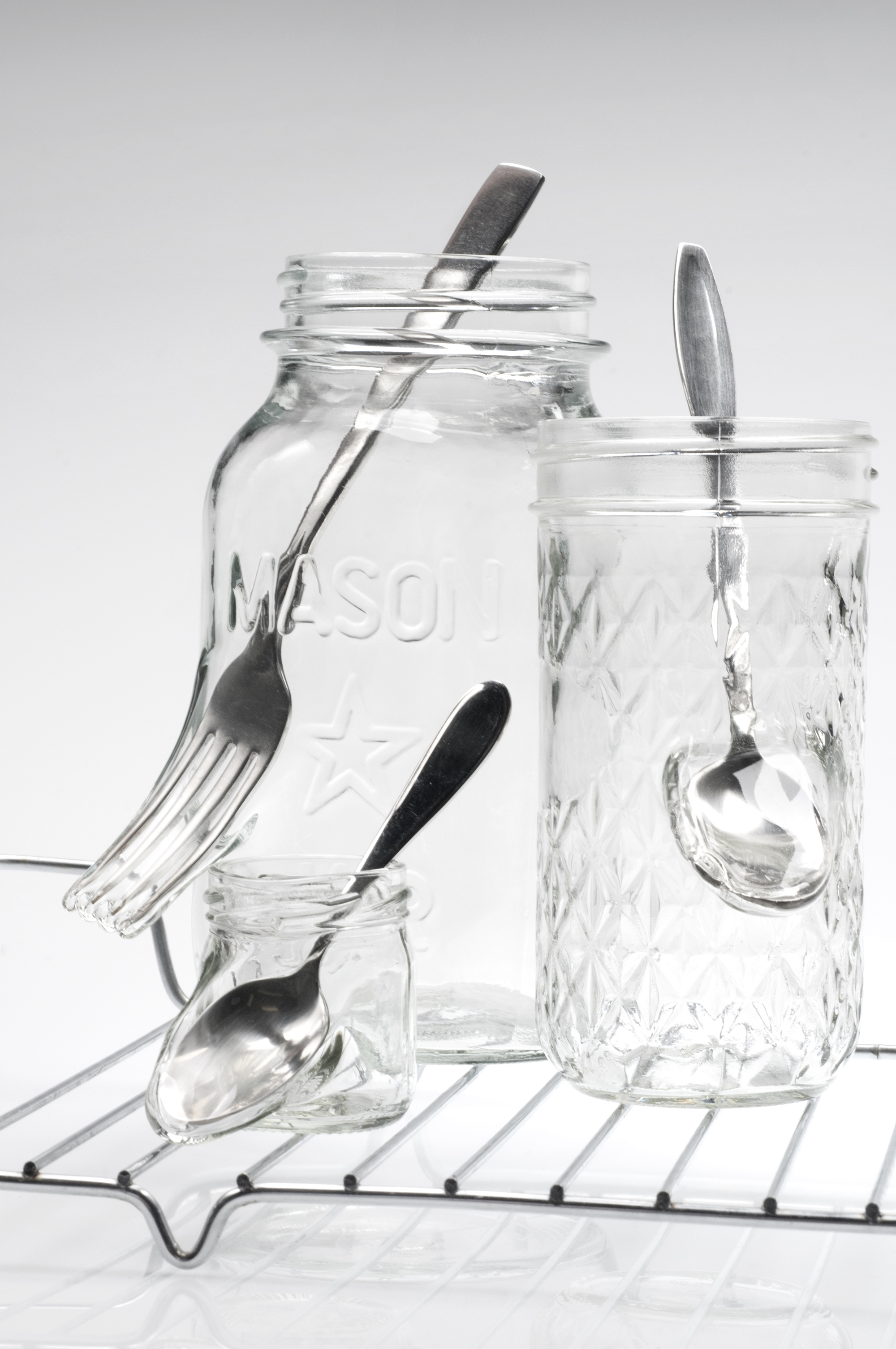 "Detail of ""Waste not want not,"" Jelly jars, cutlery, stainless steel, 8.75 x 16.25 x 9 inches, photo credit: Elizabeth Torgerson-Lamark"
