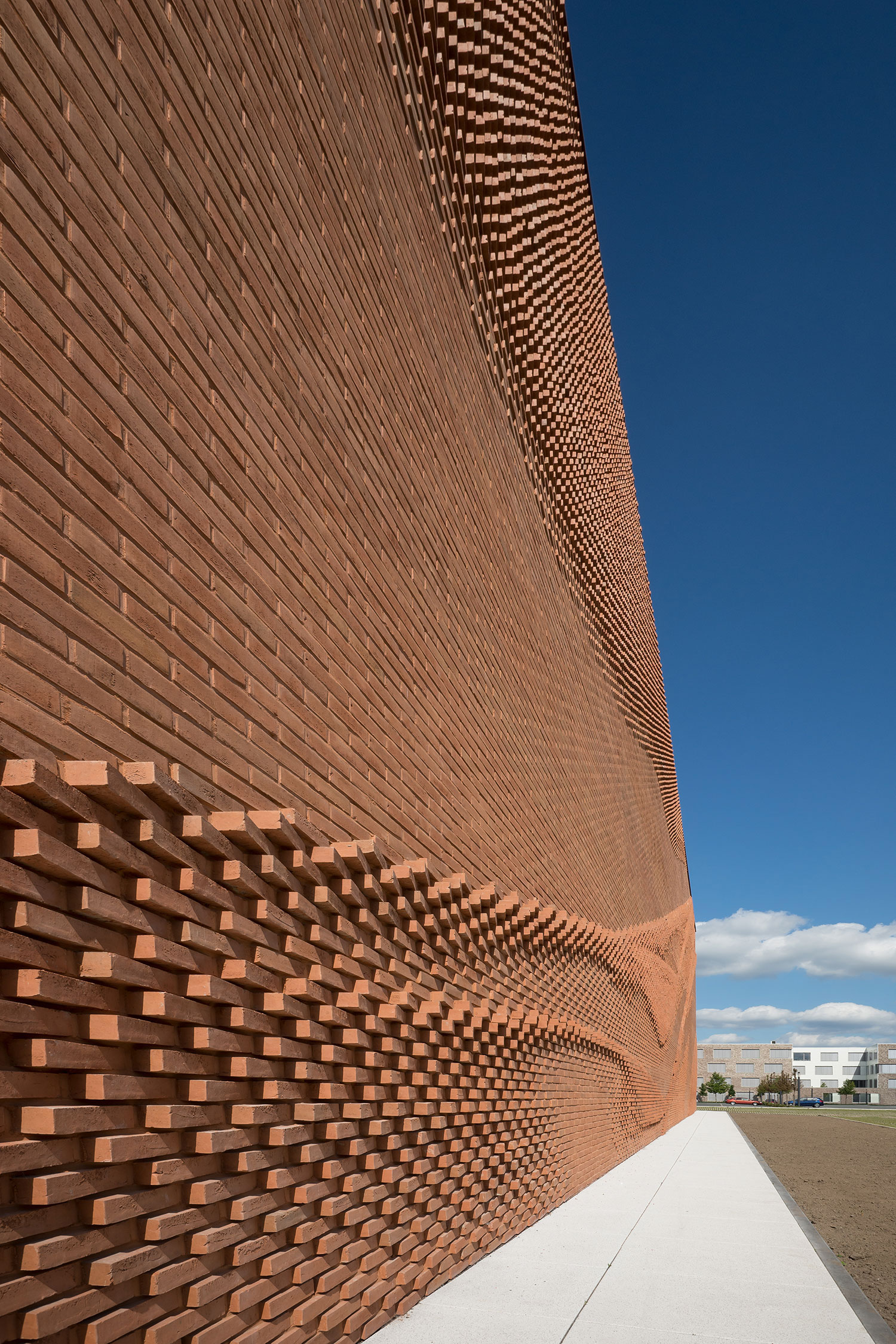 An Undulating Brick Facade Imitates the Free-Flowing Movement of Draped Fabric | Colossal