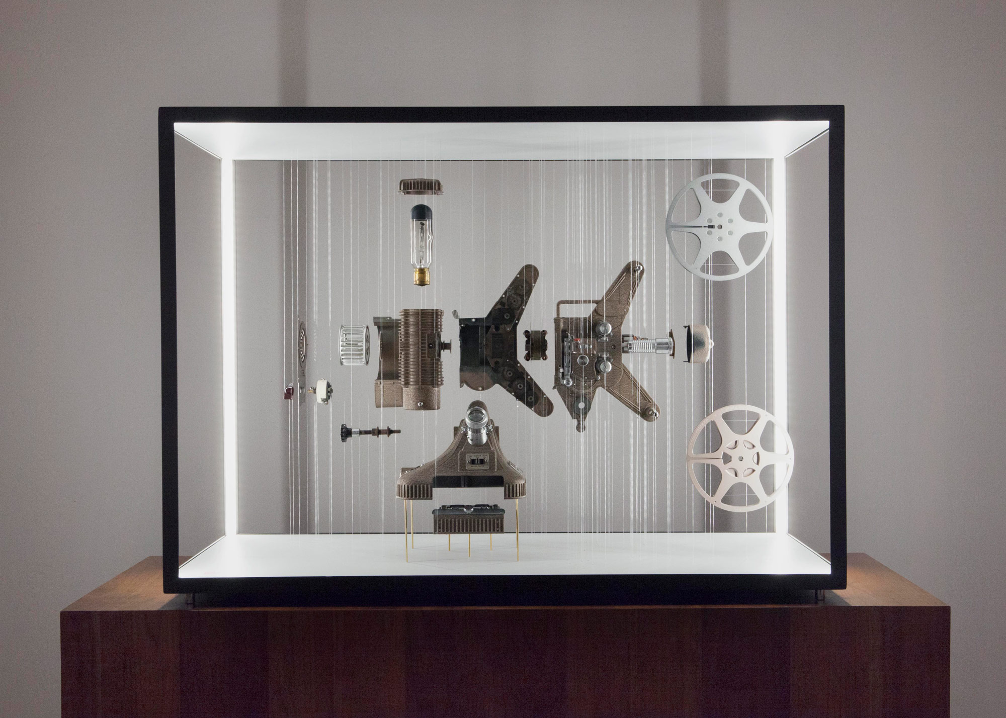 """Keystone K109"" (2018), Keystone Regal 8mm Silent Film Projector Model K-109 (c. 1953), wood, latex, steel & fluorocarbon mono-filament, LED lighting, 42 x 30 x 18 in"