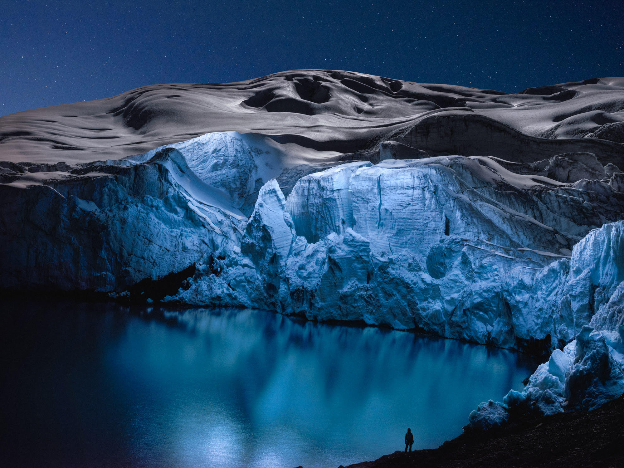 A Rare Tropical Glacier Captured at Night in Drone-Illuminated Photographs by Reuben Wu