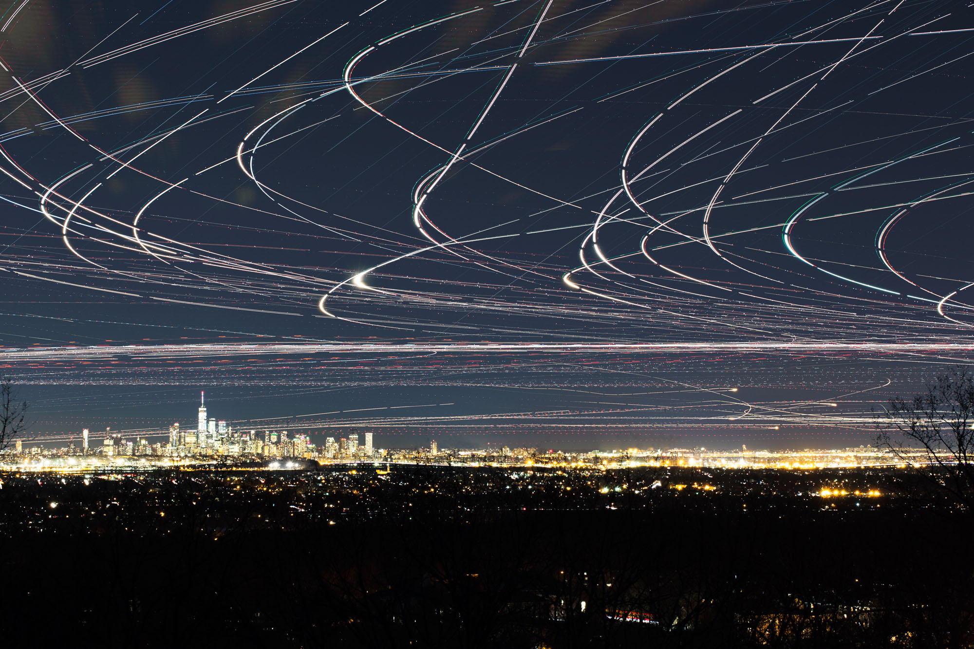 Time-Lapse Photographs Capture Swarms of Airplane Lights as They Streak Across the Night Sky
