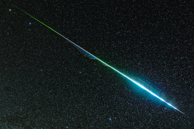 A Remarkably Colorful Geminid Meteor Streaks Across the Sky in a Singular Astrophotograph by Dean Rowe