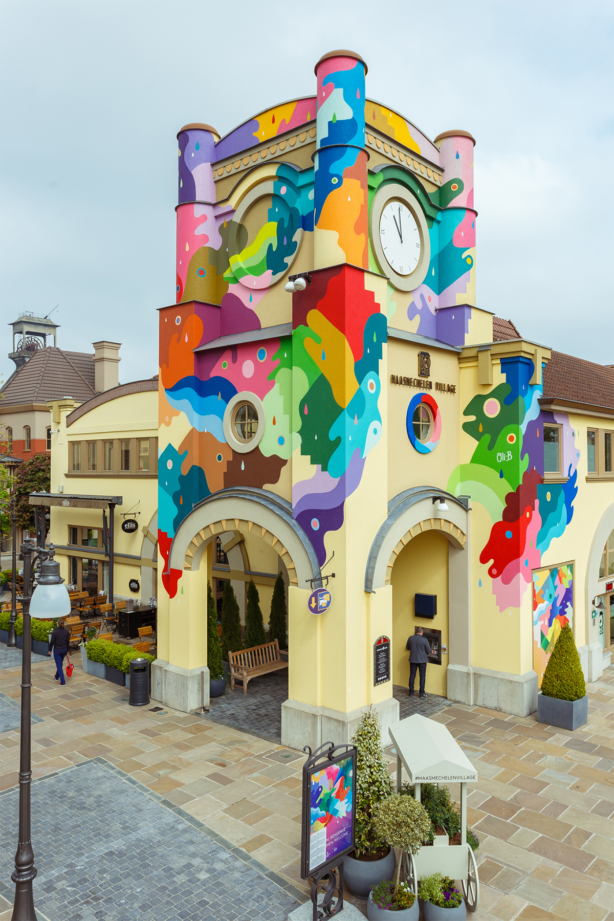 Interlocking Pools of Color Swirl Across Building Facades in Bright Murals by Oli-B | Colossal