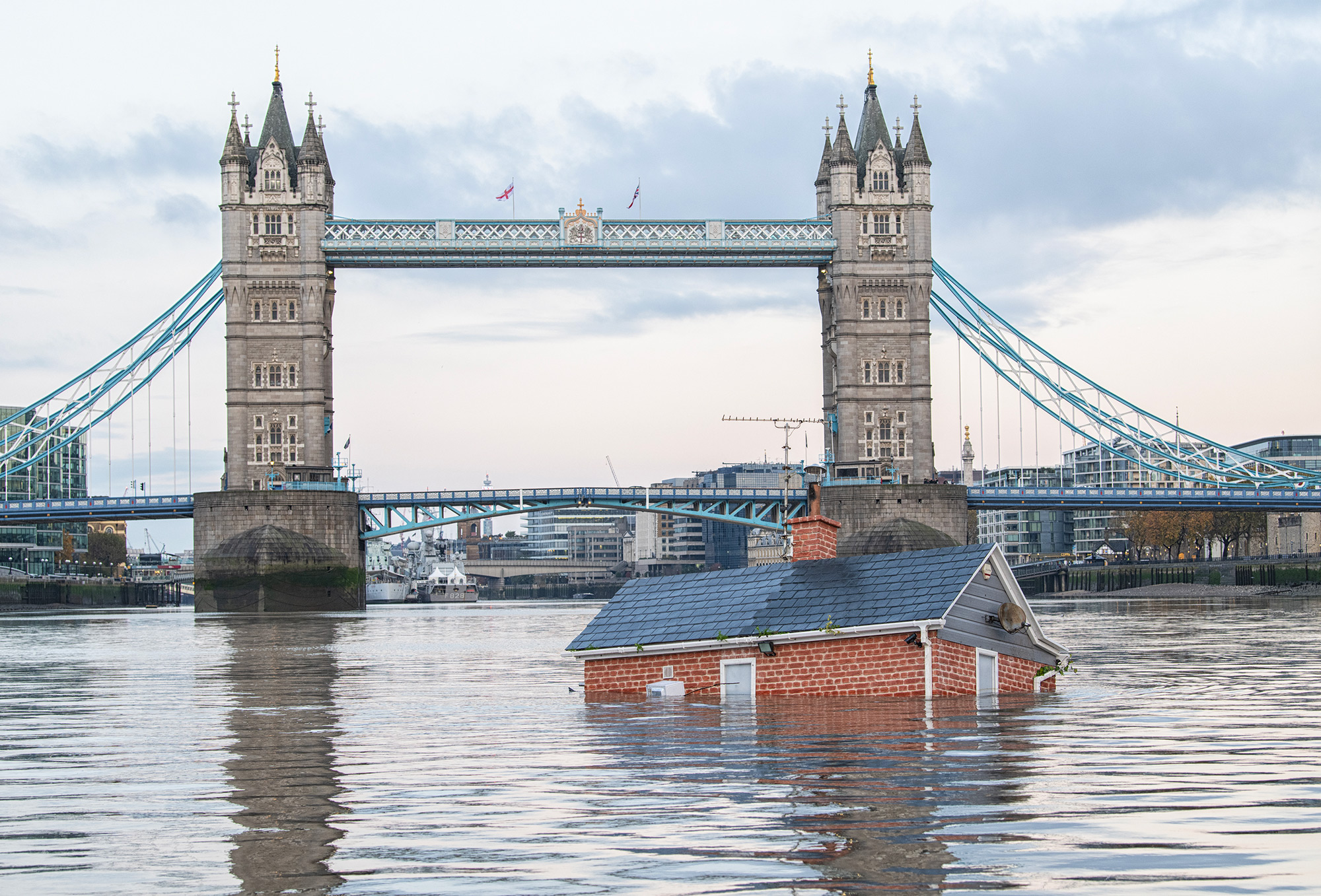 Our House is Flooding: a Semi-Submerged Life-Size Home Floats Down the River Thames