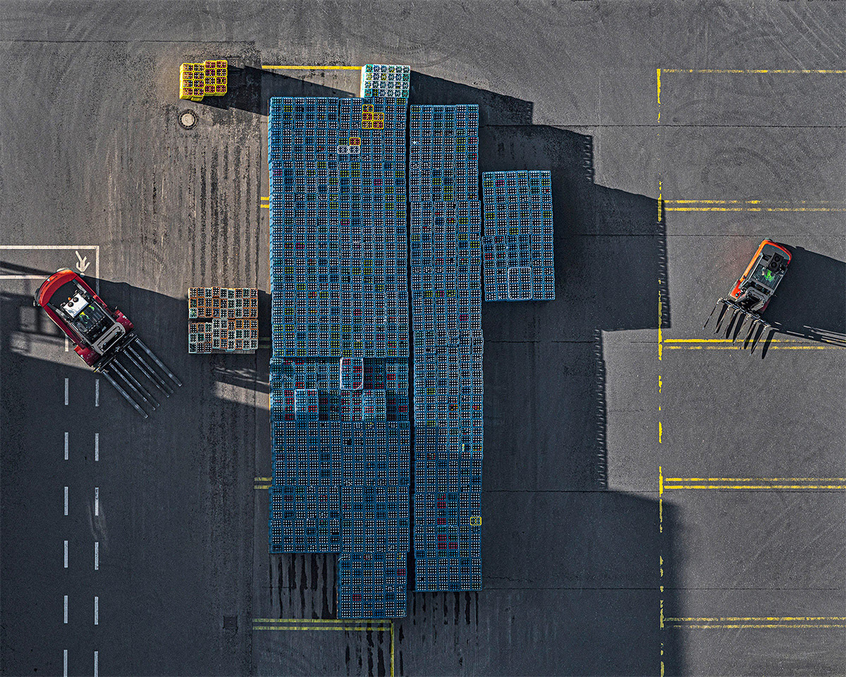 Crates Stacked in Beverage Yard Form Color-Coded Rows in Aerial Photographs by Bernhard Lang