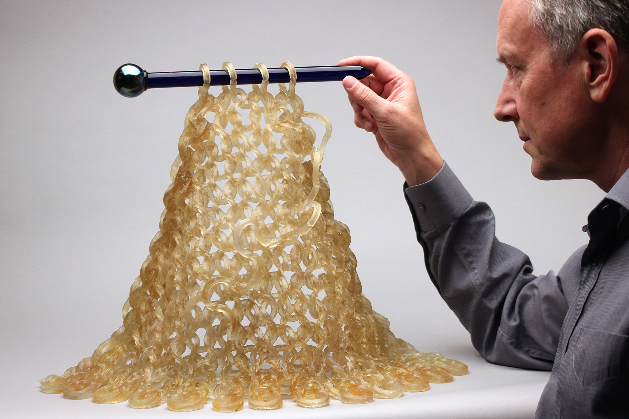 Loose Knits Flow from Hands and Needles in Glass Sculptures by Carol Milne