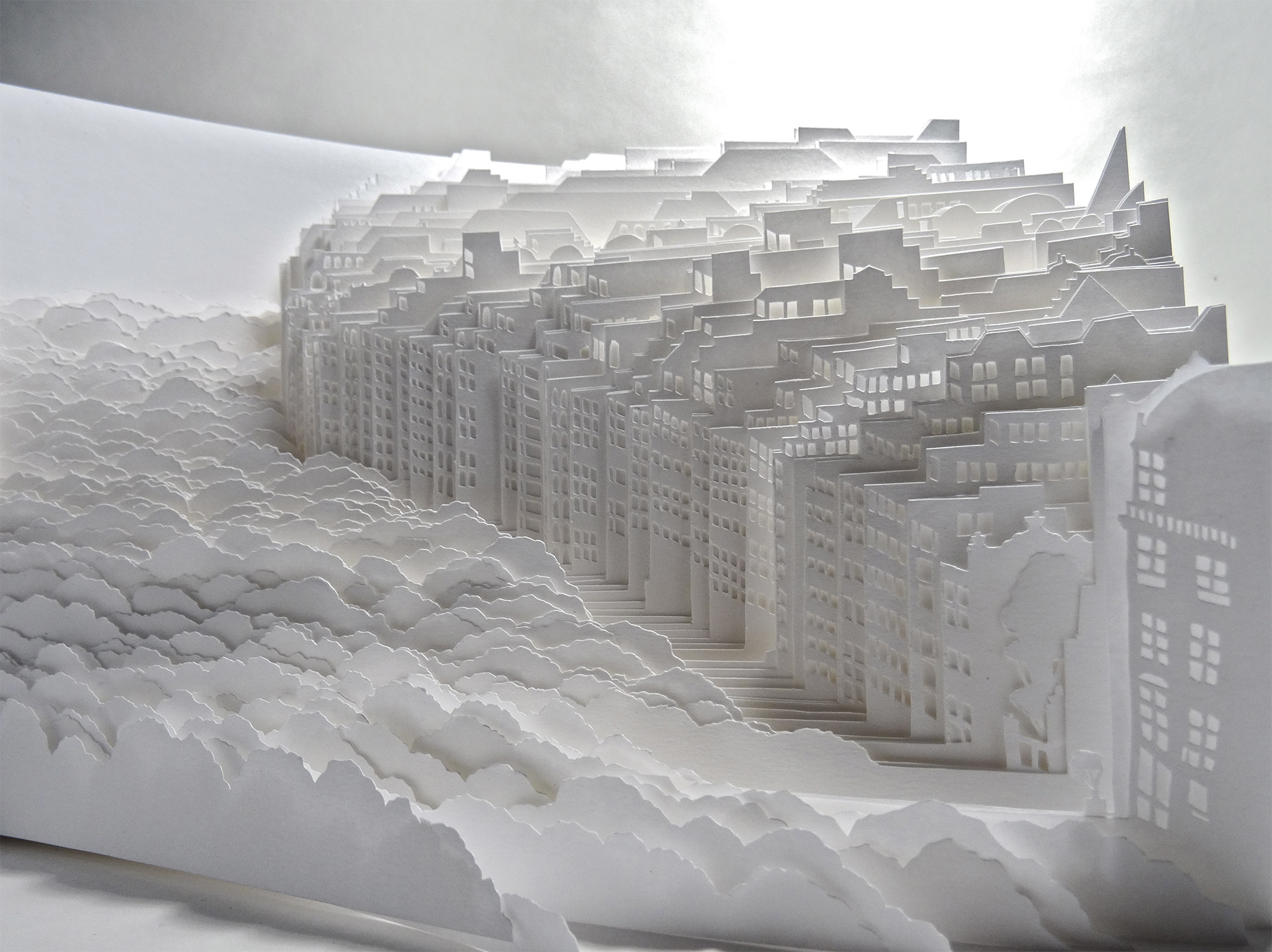 Sheets of White Paper Layered into Dense Cityscapes and Forests by Ayumi Shibata | Colossal