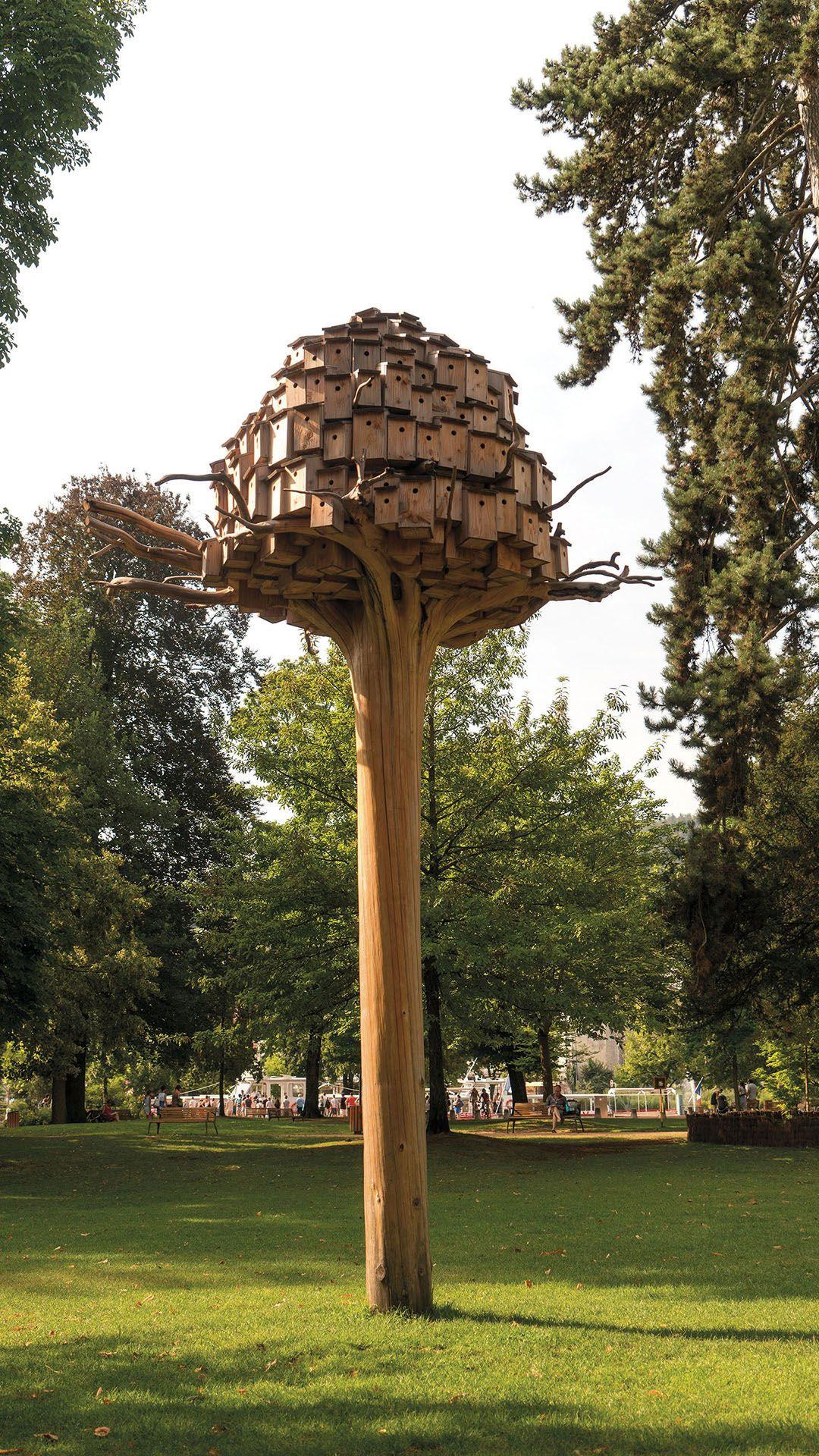 A Dense Cluster of Birdhouses by Artist Bob Verschueren Rests in a Treetop