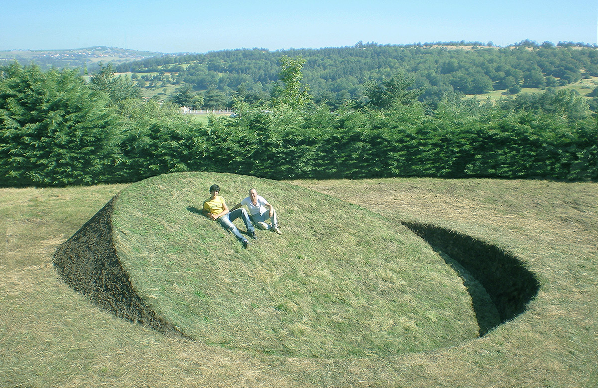 Grassy Inclines Embedded in the Ground by Tanya Preminger Throw the Earth Off Balance