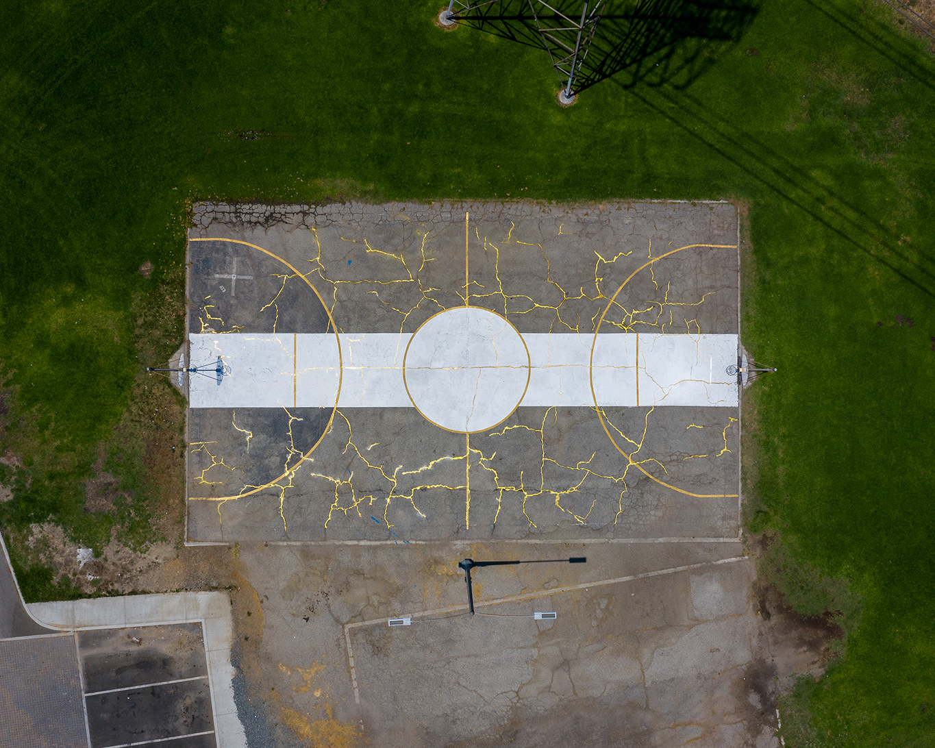 Opulent Kintsugi Installation by Artist Victor Solomon Gilds Dilapidated Basketball Court in Los Angeles
