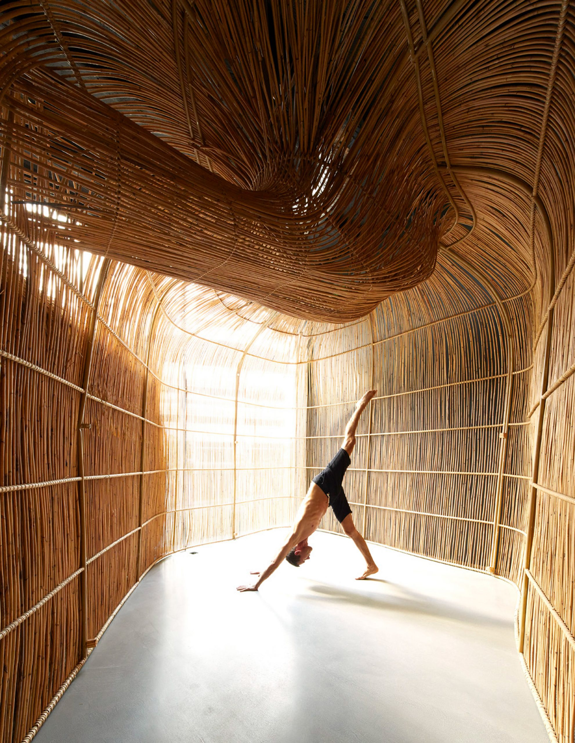 Built From Rattan, A Sinuous Structure Houses a Yoga Sanctuary in Bangkok