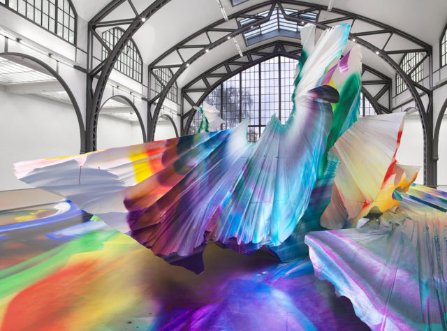 A Prismatic Installation with Giant, Abstract Forms Sweeps Across a Berlin Museum