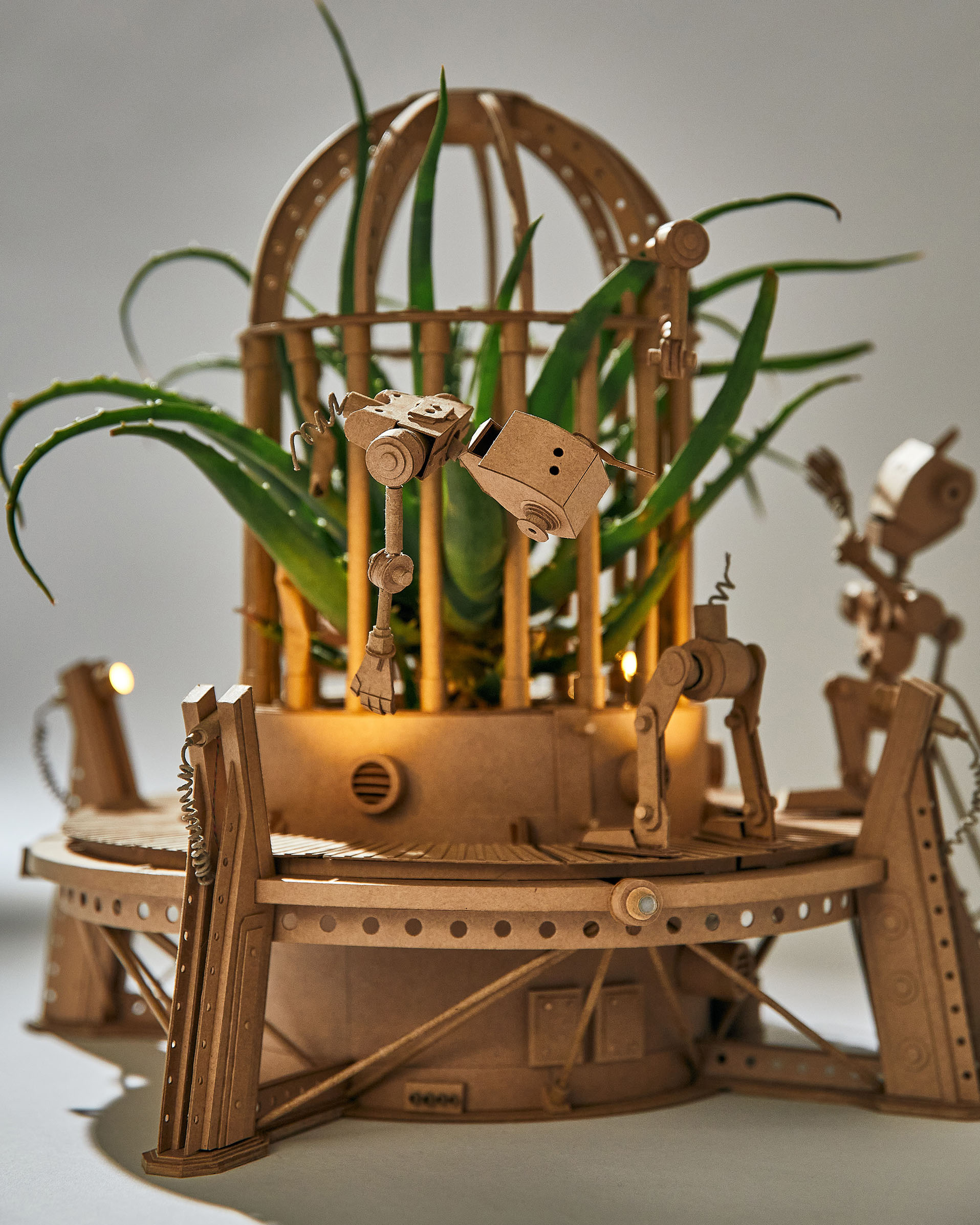 A Plant Overruns an Incredibly Intricate Cardboard Universe for Robots by Greg Olijnyk