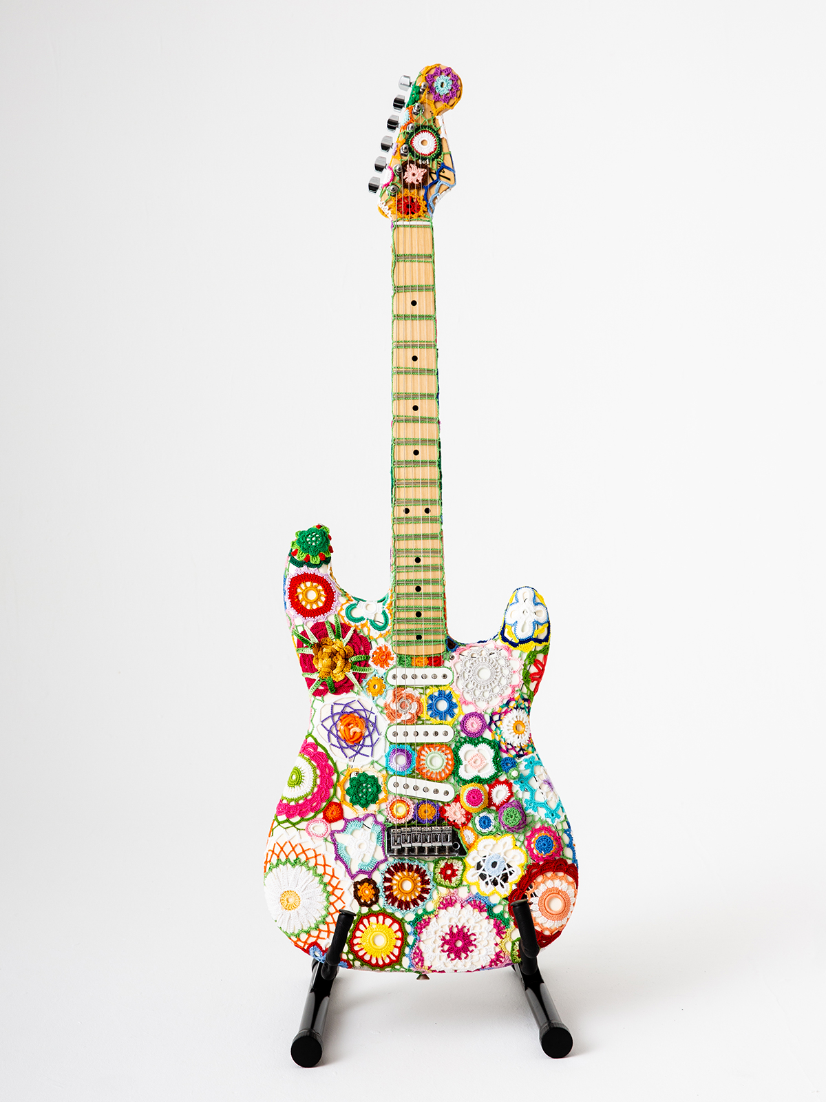 Bright Floral Crochet Wraps an Iconic Stratocaster Guitar in a Psychedelic Layer of Color