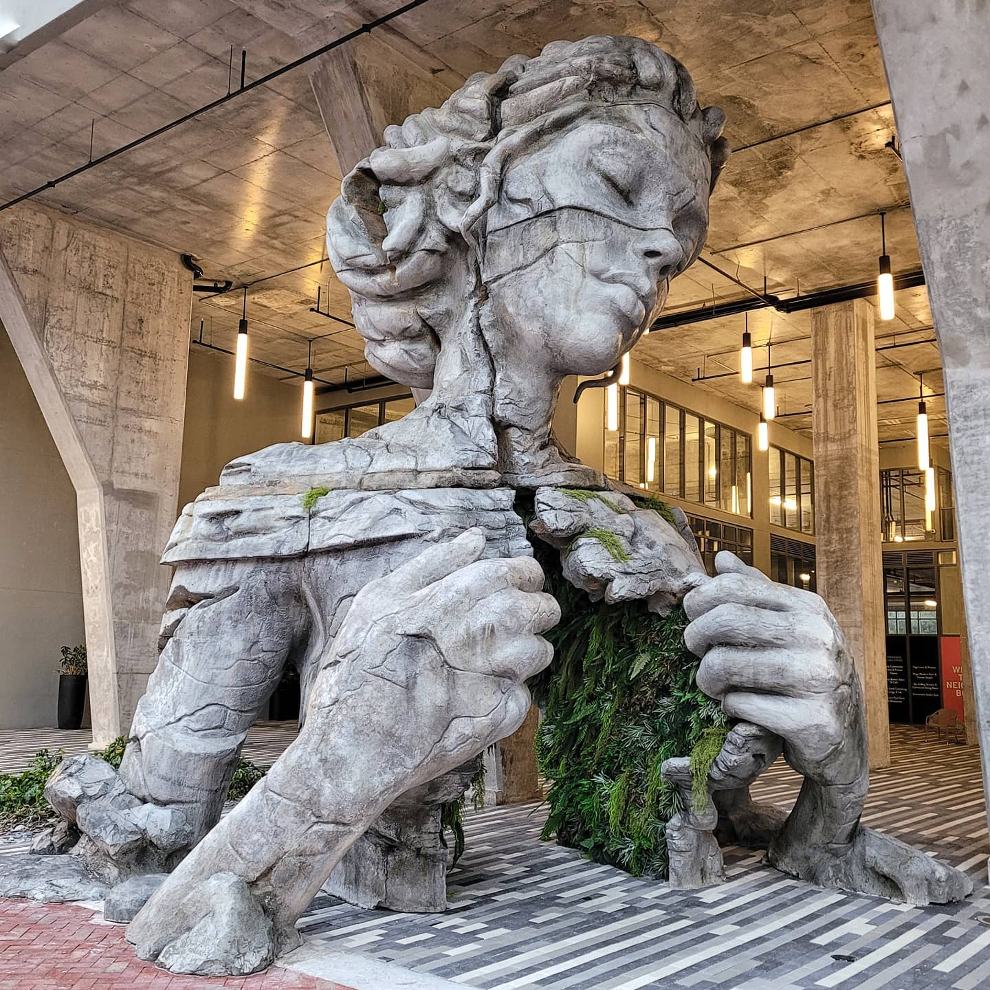 A Monumental Figure Reveals a Fern-Canopied Tunnel Inside Its Chest in Sculpture by Daniel Popper